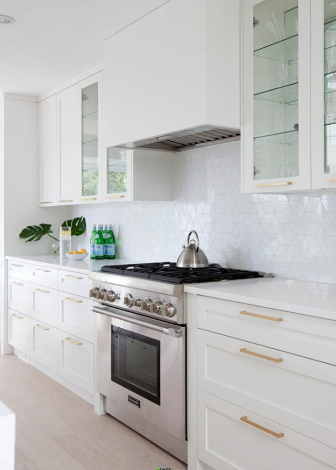 White hexagon shaped art glass mosaic.  Kitchen backsplash.
