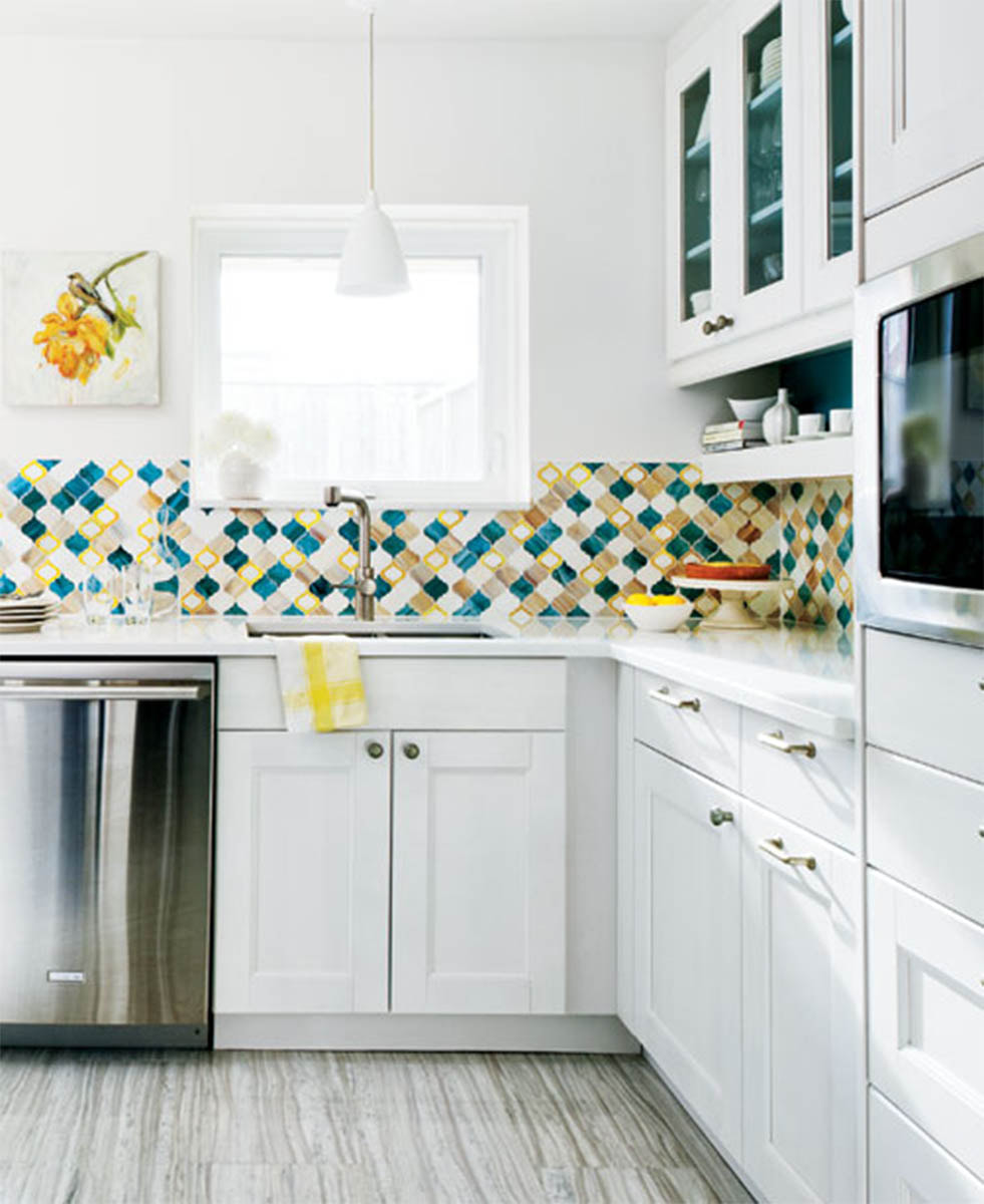 Arabesque shaped art glass mosaic in blue, green, white and amber tones.  Kitchen backsplash.