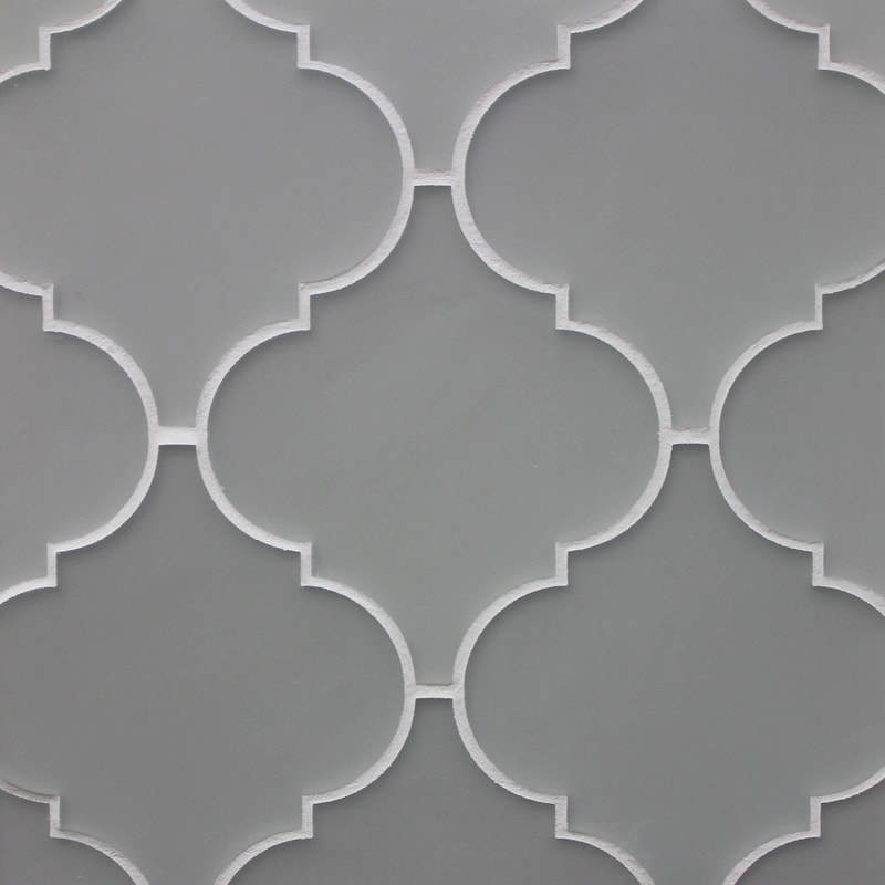 Arabesque style backpainted glass tile.