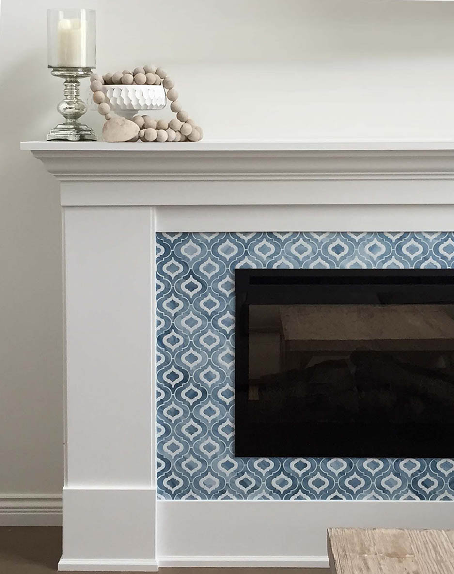 Arabesque shaped art glass mosaic in blue and white tones.  Fireplace surround.