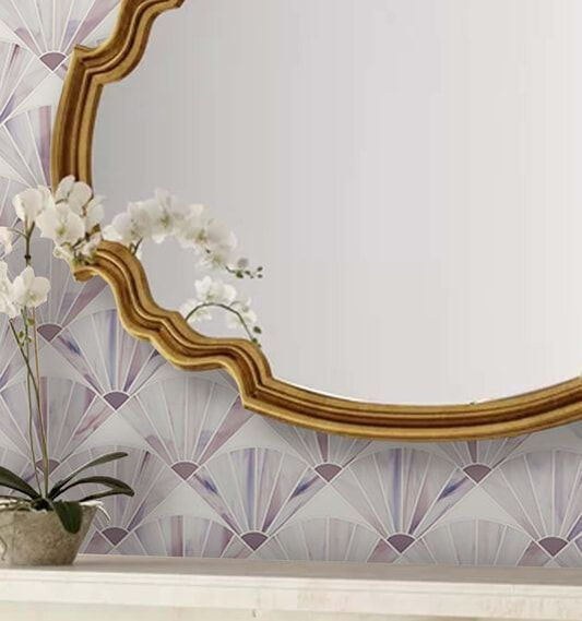 Shell shaped art glass mosaic in mauve and white.  Bath feature.