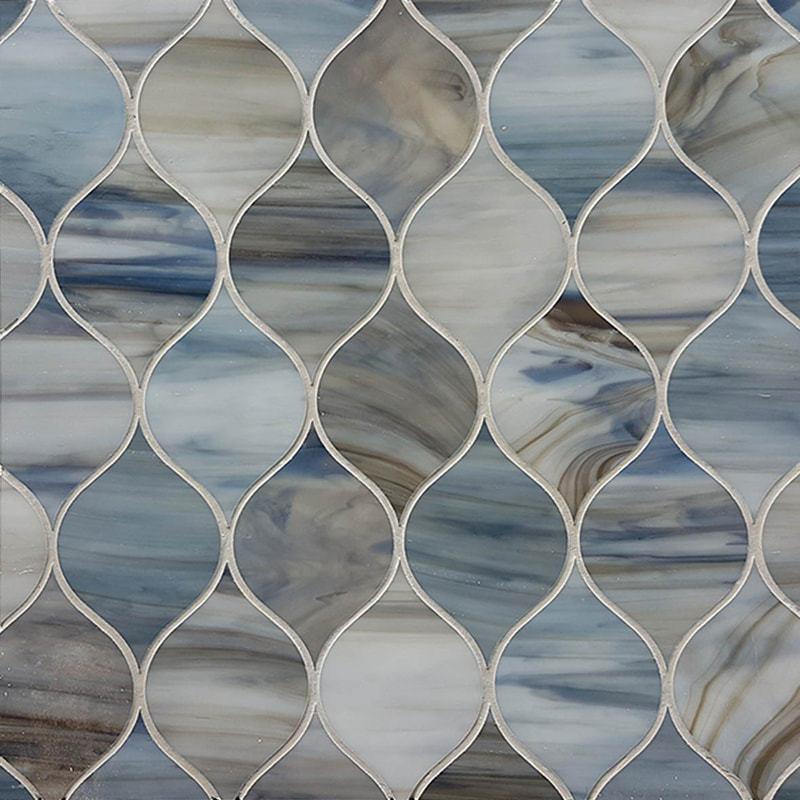 An organic leaf shape tile mosaic. Brown, beige and blues glass tile.