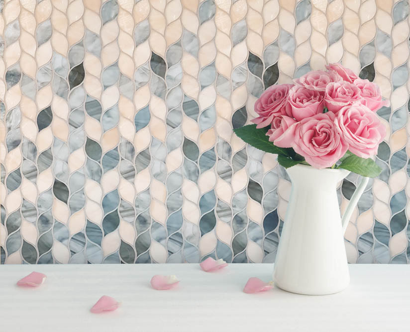 Leaf shaped art glass mosaic gradient in grays and grapefruit pink.