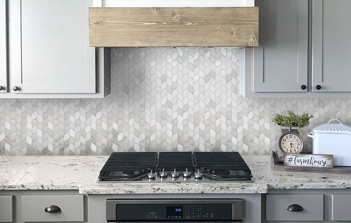 Leaf shaped art glass mosiac in white and grey,  Kitchen backsplash.