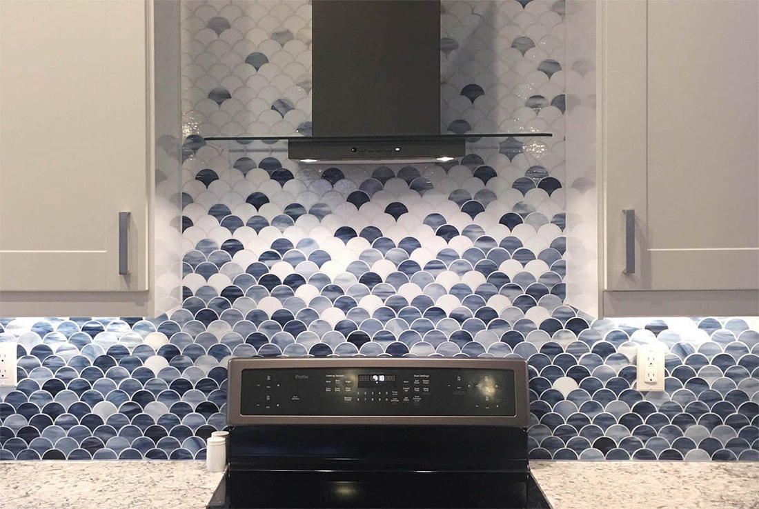 Kitchen backsplash. Scale shaped art glass mosiac in blue, white and grey