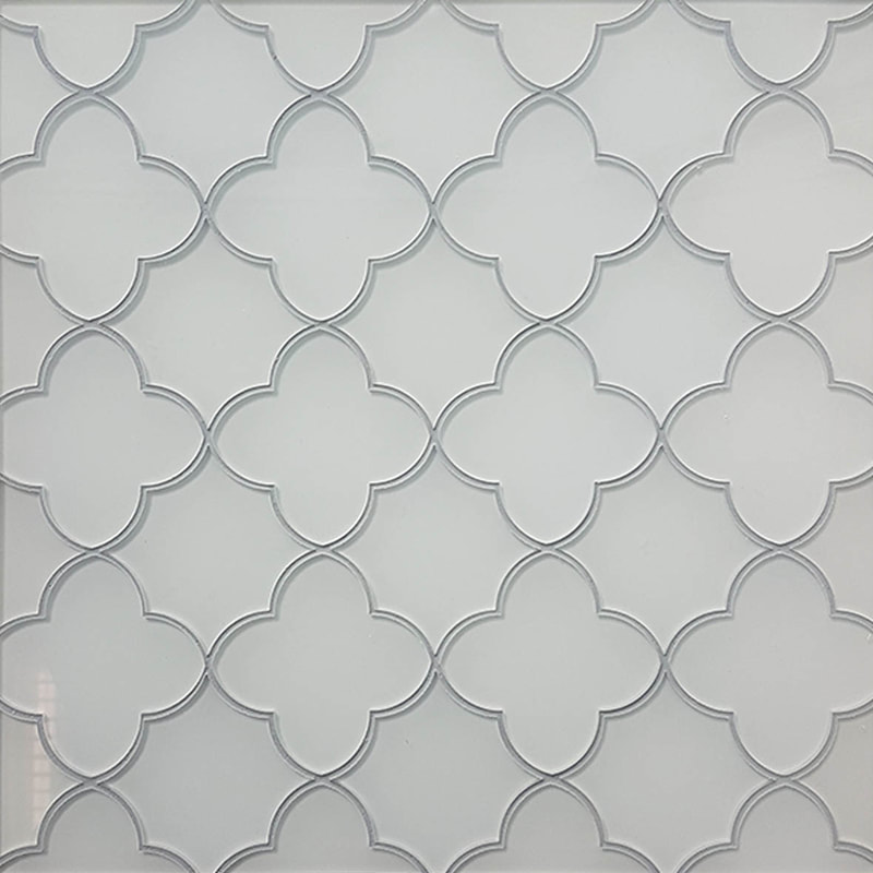 white backpainted glass tile. Quatrefoil mosaic design.